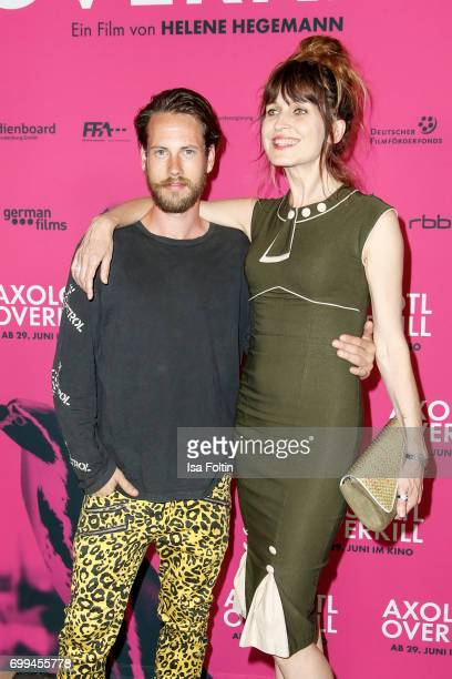 US actor John Robinson and Spain actress Araceli Jover attend the 'Axolotl Overkill' Berlin Premiere at Volksbuehne RosaLuxemburgPlatz on June 21...