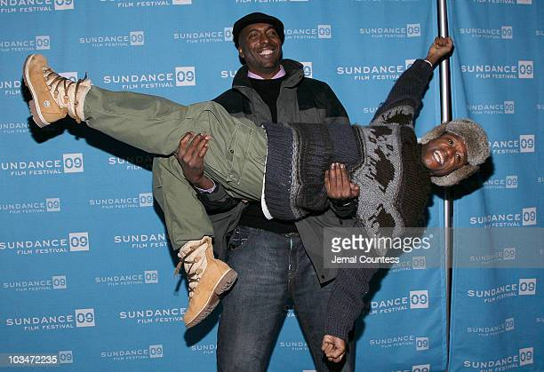 Actor John Salley and actor Tommy Davidson attend the premiere of Black Dynamite during the 2009 Sundance Film Festival at Library Center Theatre on...