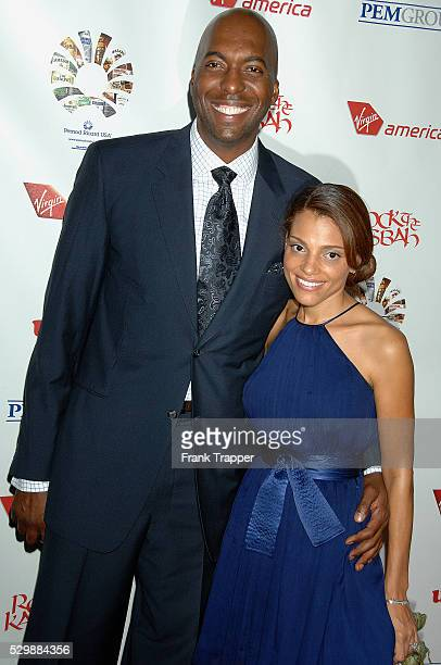 Actor John Salley and wife arrive at Sir Richard Bransons Rock The Kasbah benefitting Virgin Unite held at the Hollywood Roosevelt Hotel