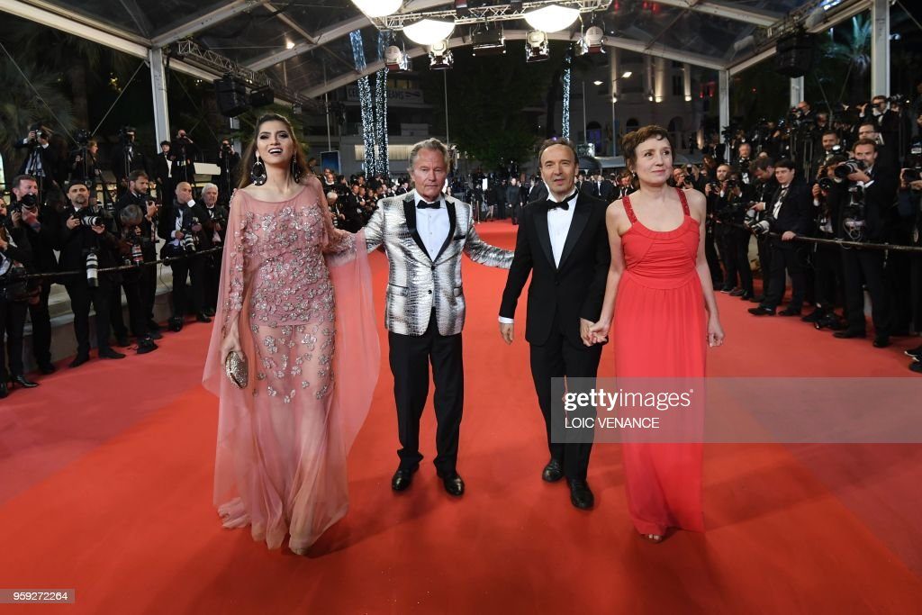 US actor John Savage (2ndL) and his partner US actress Blanca Blanco (L) arrive with Italian actor and director Roberto Benigni (2ndL) and his wife Italian actress and producer Nicoletta Braschi on May 16, 2018 for the screening of the film 'Dogman' at the 71st edition of the Cannes Film Festival in Cannes, southern France.
