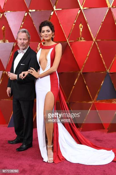 US actor John Savage and US actress Blanca Blanco arrive for the 90th Annual Academy Awards on March 4 in Hollywood California / AFP PHOTO / ANGELA...