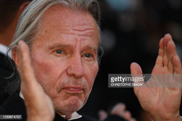 """Actor John Savage applauds as he arrives for the screening of the film """"Stillwater"""" at the 74th edition of the Cannes Film Festival in Cannes,..."""