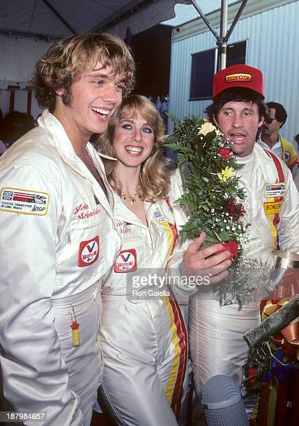 Actor John Schneider, actress Jenilee Harrison and actor Robert Hays attend the Fifth Annual Toyota Pro/Celebrity Race - Race Day on March 14, 1981...