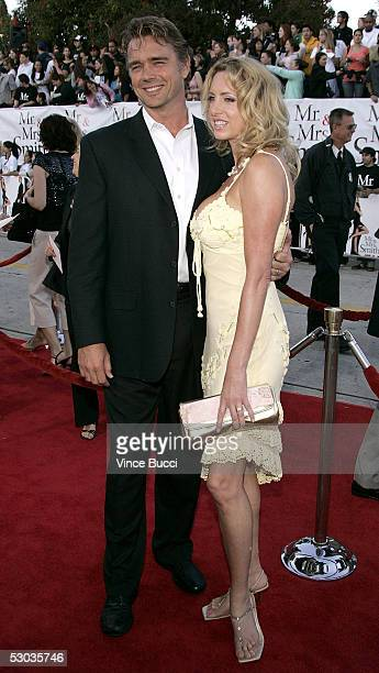 Actor John Schneider and Elly Castle arrive at the premiere of Mr and Mrs Smith at the Mann Village Theater on June 7 2005 in Westwood California