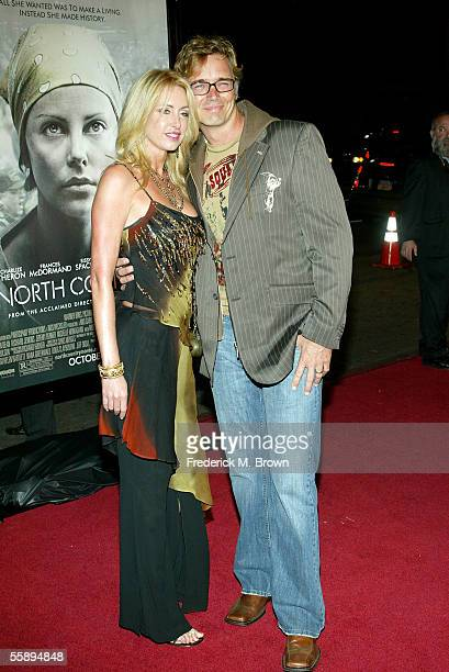 Actor John Schneider and his wife Elly Castle arrive at the Warner Brospremiere of North Country held at the Grauman's Chinese Theatre on October 10...