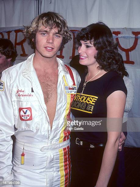 Actor John Schneider and Penthouse Pet attend the Fifth Annual Toyota Pro/Celebrity Race Race Day on March 14 1981 at the Long Beach Street Circuit...