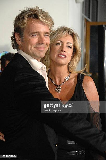 Actor John Schneider and wife Elly Castle arrive at the world premiere of Elizabeth The Golden Age held at Gibson Amphitheatre and City Walk Cinemas...