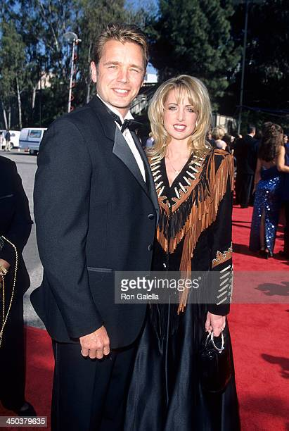 Actor John Schneider and wife Elly Castle attend the 34th Annual Academy of Country Music Awards on May 5 1999 at the Universal Amphitheatre in...