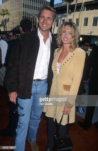 Actor John Schneider and wife Elly Castle attend the Screening of the Digitally Restored Gone With the Wind on June 24 1998 at the Academy of Motion...