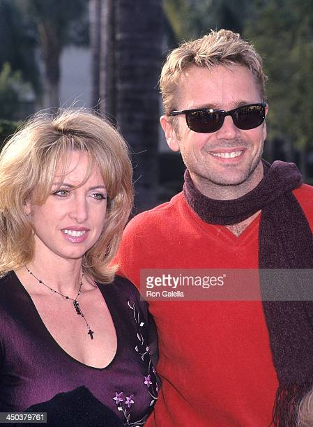 Actor John Schneider and wife Elly Castle attend the Snow Day Hollywood Premiere on January 29 2000 at Paramount Theatre Paramount Pictures Studios...