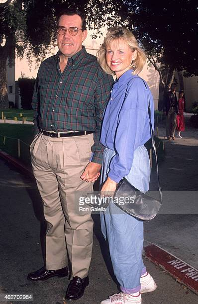 "Actor John Schuck and girlfriend Harrison Houle attend the ""Oliver & Company"" Burbank Premiere on November 6, 1988 at Studio Theatre, Walt Disney..."