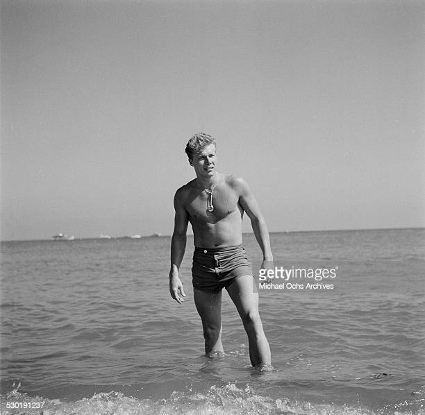 Actor John Smith poses on the beach in Los AngelesCA