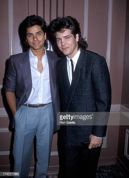 Actor John Stamos and actor Michael Damian attend the Motion Picture Television Radio and Recording Industries' 35th Annual Communion Breakfast on...