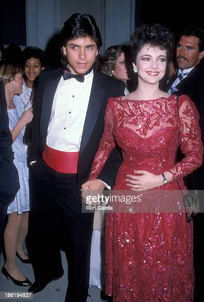 Actor John Stamos and actress Emma Samms attend the 26th Annual Grammy Awards on February 28 1984 at the Shrine Auditorium in Los Angeles California