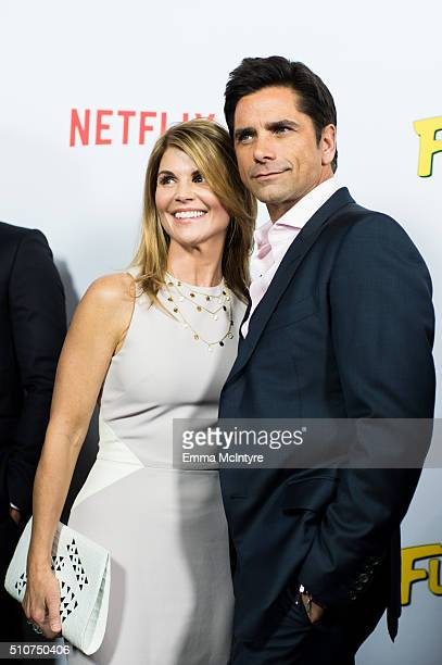 Actor John Stamos and actress Lori Loughlin attend the premiere of Netflix's 'Fuller House' at Pacific Theatres at The Grove on February 16 2016 in...