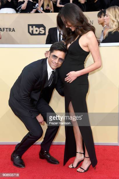 Actor John Stamos and Caitlin McHugh attend the 24th Annual Screen Actors Guild Awards at The Shrine Auditorium on January 21 2018 in Los Angeles...