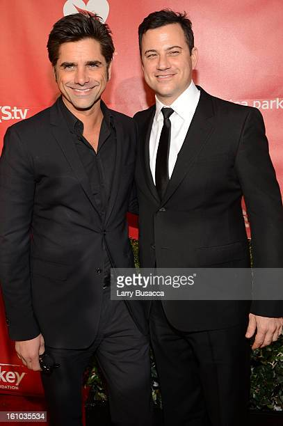 Actor John Stamos and comedian Jimmy Kimmel arrive at MusiCares Person Of The Year Honoring Bruce Springsteen at Los Angeles Convention Center on...