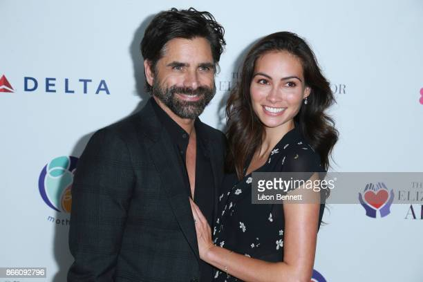 Actor John Stamos and fiancee Caitlin McHugh attends the Zac Posen And Paris Jackson Host Event Supporting mothers2mothers And ETAF on October 24...