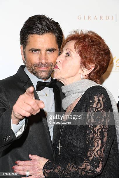 Actor John Stamos and mother Loretta Phillips arrive at the 21st ELLA Awards at The Beverly Hilton Hotel on February 20 2014 in Beverly Hills...