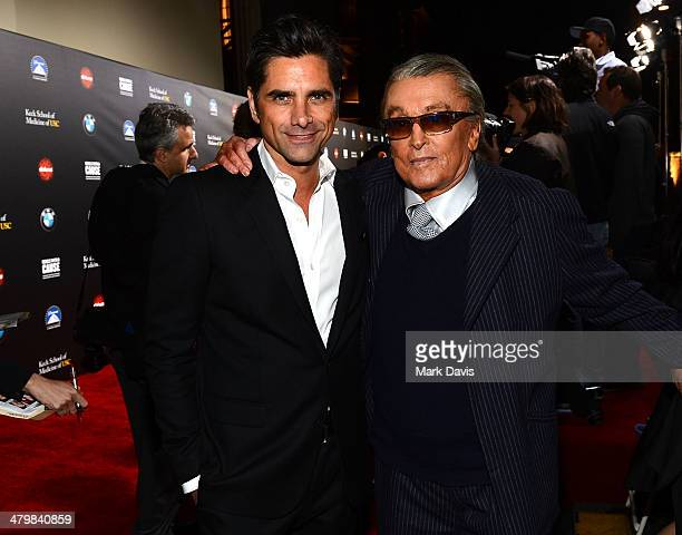 Actor John Stamos and producer Robert Evans attend the 2nd Annual 'Rebels With A Cause' Gala held at Paramount Studios on March 20 2014 in Hollywood...