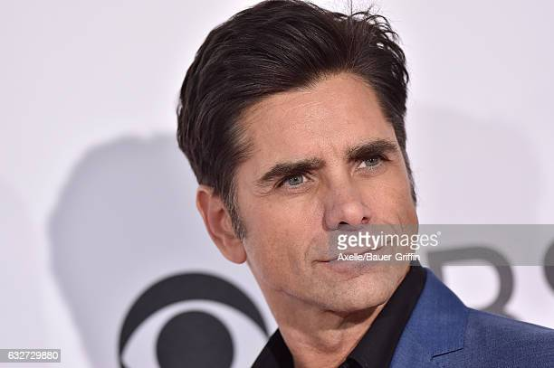 Actor John Stamos arrives at the 2017 People's Choice Awards at Microsoft Theater on January 18 2017 in Los Angeles California