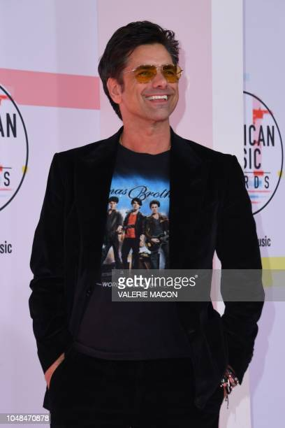US actor John Stamos arrives at the 2018 American Music Awards on October 9 in Los Angeles California