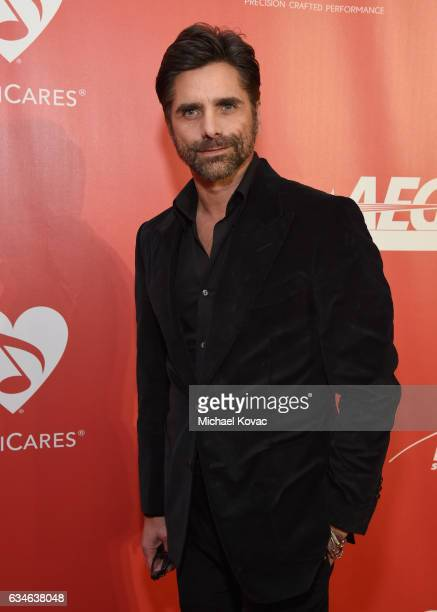 Actor John Stamos attends MusiCares Person of the Year honoring Tom Petty at the Los Angeles Convention Center on February 10 2017 in Los Angeles...