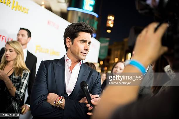 Actor John Stamos attends the premiere of Netflix's 'Fuller House' at Pacific Theatres at The Grove on February 16 2016 in Los Angeles California