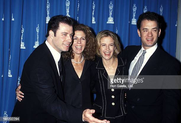 Actor John Travolta, actress Rita Wilson, actress Kelly Preston and actor Tom Hanks attend the 67th Annual Academy Awards Nominees Luncheon on March...