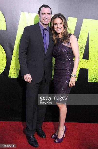 Actor John Travolta and actress Kelly Preston arrive at the Los Angeles Premiere 'Savages' at Mann Village Theatre on June 25 2012 in Westwood...
