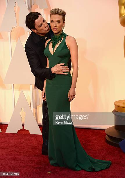 Actor John Travolta and actress Scarlett Johansson attend the 87th Annual Academy Awards at Hollywood Highland Center on February 22 2015 in...