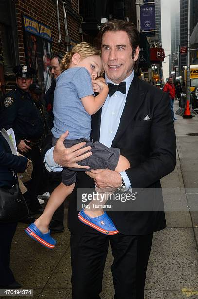 Actor John Travolta and Benjamin Travolta enter the Late Show With David Letterman taping at the Ed Sullivan Theater on April 20 2015 in New York City