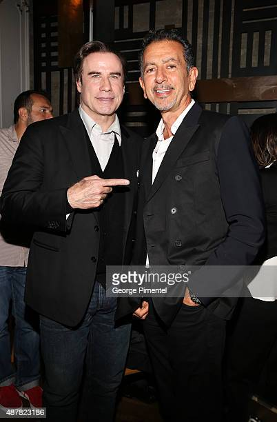 Actor John Travolta and Charles Khabouth attend the 'Gotti' Party hosted by Ciroc and Stella Artois at Byblos on September 11 2015 in Toronto Canada