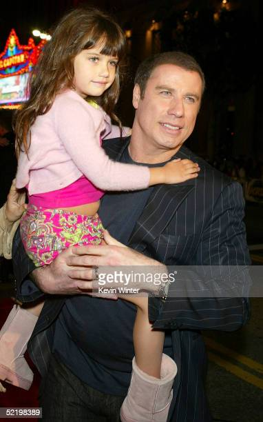 Actor John Travolta and daughter Ella Bleu walk on the red carpet during MGM's premiere of Be Cool at Grauman's Chinese Theatre on February 14 2005...