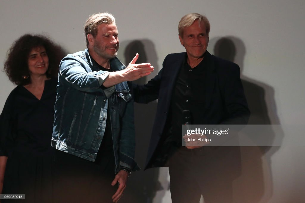 Actor John Travolta and director Randall Kleiser attend the 'Grease' 40th Anniversary Screening during the 71st annual Cannes Film Festival at on May 16, 2018 in Cannes, France.