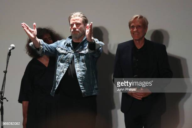 Actor John Travolta and director Randall Kleiser attend the 'Grease' 40th Anniversary Screening during the 71st annual Cannes Film Festival at on May...