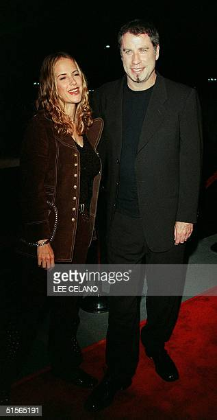 Actor John Travolta and his wife Kelly arrive for Barabara Streisand's concert 20 September 2000 at the Staples Center in Los Angeles Streisand is...