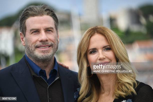 US actor John Travolta and his wife US actress Kelly Preston pose on May 15 2018 during a photocall for the film Gotti at the 71st edition of the...