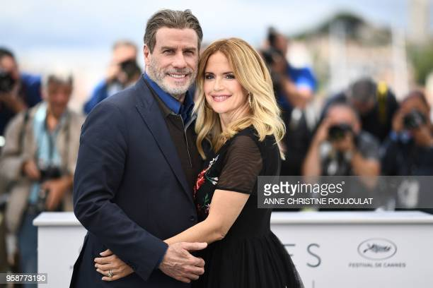 TOPSHOT US actor John Travolta and his wife US actress Kelly Preston pose on May 15 2018 during a photocall for the film Gotti at the 71st edition of...