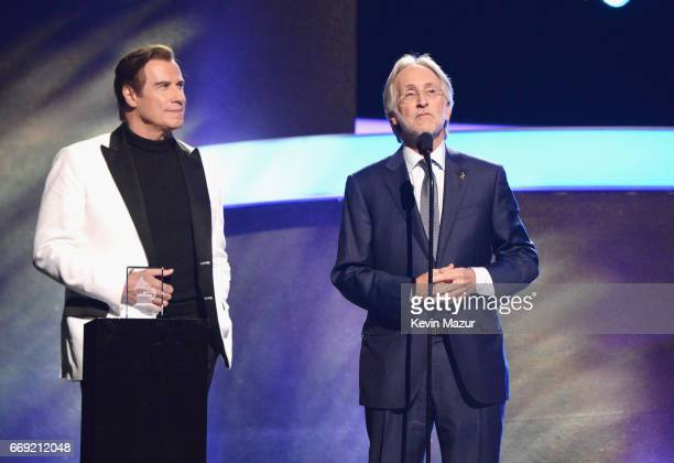 Actor John Travolta and President/CEO of The Recording Academy and GRAMMY Foundation President/CEO Neil Portnow speak onstage during 'Stayin' Alive A...