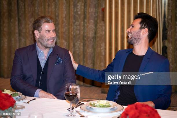 Actor John Travolta and producer Andrea Iervolino attend Ambi Tatatu Gala Honouring 'The Poison Rose' on July 15 2018 in Savannah Georgia