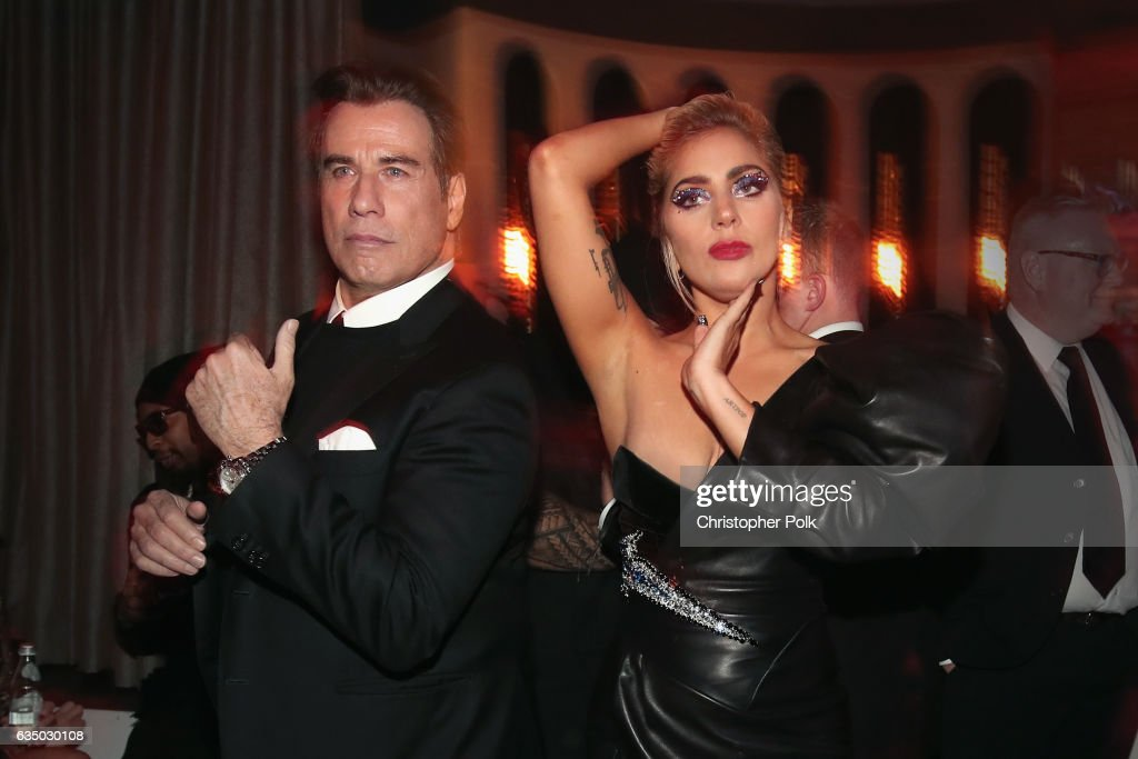 Actor John Travolta (L) and recording artist Lady Gaga attend Interscope's Grammy After Party with Lady Gaga at the Peppermint Club on February 12, 2017 in Los Angeles, California.
