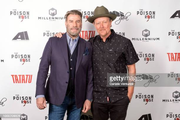Actor John Travolta and Robert Patrick attend Ambi Tatatu Gala Honouring 'The Poison Rose' on July 15 2018 in Savannah Georgia