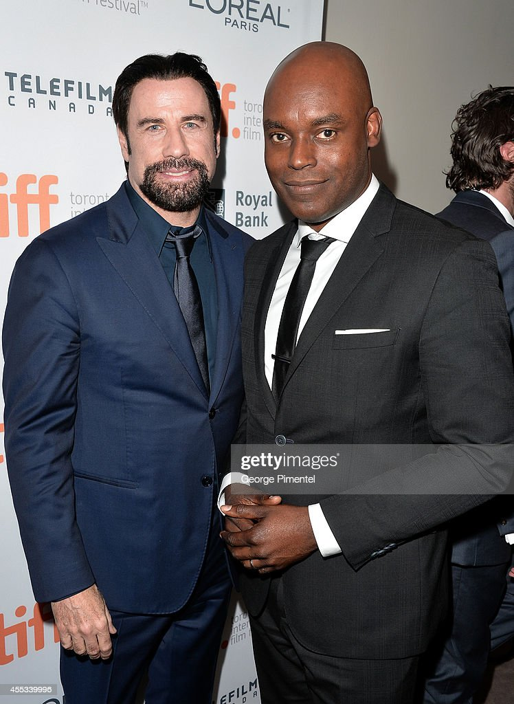 Actor John Travolta (L) and TIFF Artistic Director Cameron Bailey attend 'The Forger' premiere during the 2014 Toronto International Film Festival at Roy Thomson Hall on September 12, 2014 in Toronto, Canada.