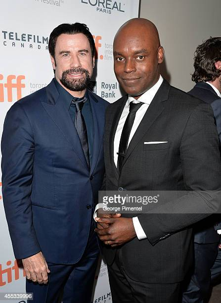 Actor John Travolta and TIFF Artistic Director Cameron Bailey attend 'The Forger' premiere during the 2014 Toronto International Film Festival at Roy...