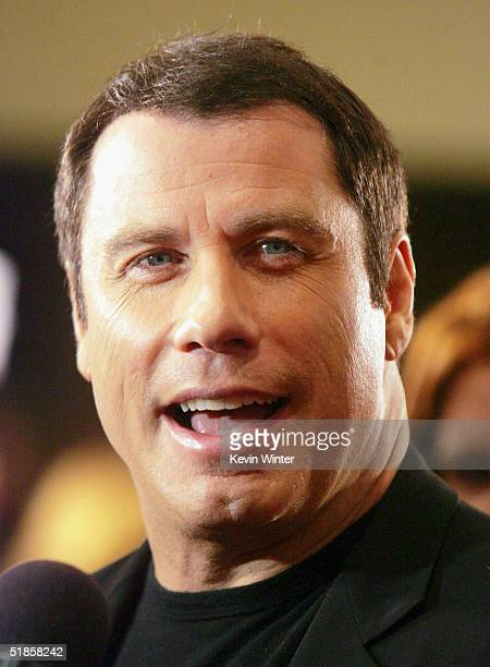 Actor John Travolta arrives at the premiere of Lions Gate's A Love Song for Bobby Long at the Bruin Theatre on December 13 2004 in Los Angeles...