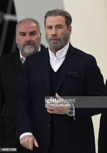 US actor John Travolta arrives to attend a panel discussion at the Apex Convention Center in the Saudi capital Riyadh on December 15 2017 American...