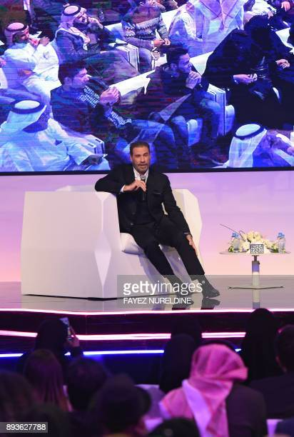 US actor John Travolta attends a panel discussion at the Apex Convention Center in the Saudi capital Riyadh on December 15 2017 American entertainers...