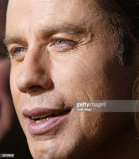 Actor John Travolta attends the Los Angeles premiere of the Lion's Gate film 'The Punisher' at the ArcLight Cinerama Dome April 12 2004 in Hollywood...