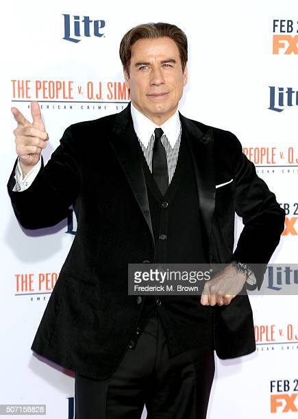 Actor John Travolta attends the premiere of FX's American Crime Story The People V OJ Simpson at Westwood Village Theatre on January 27 2016 in...